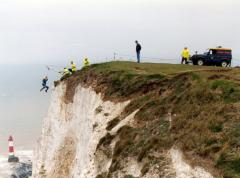 Cliff Man starting his descent over Beachy head